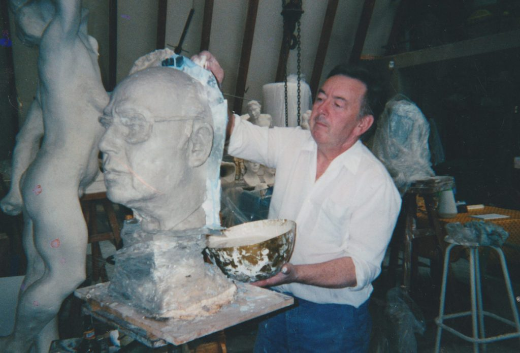 Moulder Michel making a plaster original from a clay portrait (Eric Ericson)