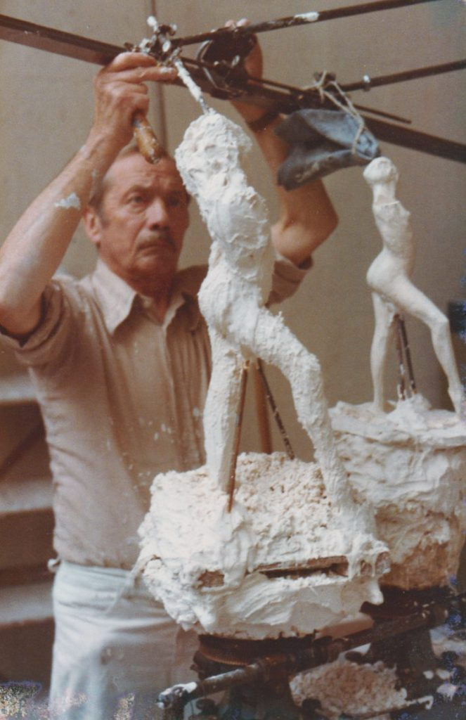 Georges Bigel in the studio working on another sculptor's work
