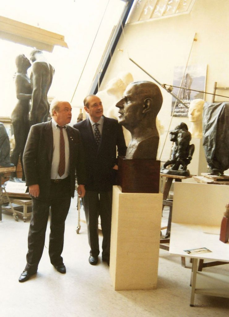 French President Jacques Chirac admiring the bust of Charles de Gaule